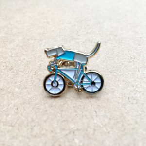 Dog on a bike pin