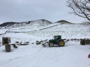 Tractor ploughing snow, a winter in fryup dale
